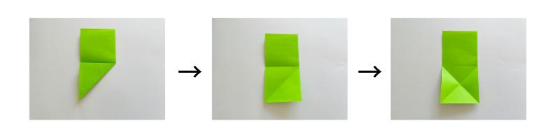 折り紙を真ん中の線に合わせて下半分を三角に折り、開く。折り目が×(バツ)になるように反対側も折る。
